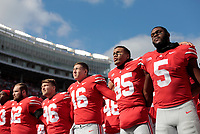 """Ohio State Buckeyes players sing """"Carmen Ohio"""" following the Buckeyes' 30-14 victory against the Minnesota Golden Gophers during a NCAA college football game on Saturday, October 13, 2018 at Ohio Stadium in Columbus, Ohio. [Joshua A. Bickel/Dispatch]"""