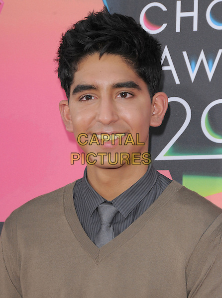 DEV PATEL .at the 23rd Annual Nickelodeon Kids' Choice Awards 2010 held at Pauley Pavilion in Westwood, California, USA,.March 27th 2010                                                                                       .arrivals kids portrait headshot grey gray tie shirt brown v-neck jumper smiling sweater .CAP/RKE/DVS.©DVS/RockinExposures/Capital Pictures