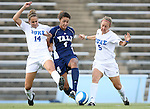 07 September 2007: Yale's Caitlin Collins (4) gets squeezed by Duke's Christie MacDonald (14) and Jane Alukonis (5). The Duke University Blue Devils defeated the Yale University Bulldogs 1-0 at Fetzer Field in Chapel Hill, North Carolina in an NCAA Division I Women's Soccer game, and part of the annual Nike Carolina Classic tournament.