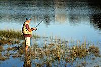 Man fishing, Mill Pond, Orleans, Cape Cod, Massachusetts, USA