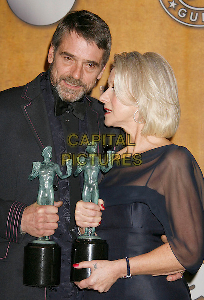 "JEREMY IRONS & HELEN MIRREN.Winners of the awards for ""Male Actor In A TV Movie Or MiniSeries"" and ""Female Actor In A TV Movie Or MiniSeries"" for ""Elizabeth I"".13th Annual Screen Actors Guild (SAG) Awards held at the Shrine Auditorium - pressroom,  Los Angeles, California, USA, 28 January 2007..press room half length awards trophies.CAP/ADM/RE.©Russ Elliot/AdMedia/Capital Pictures."