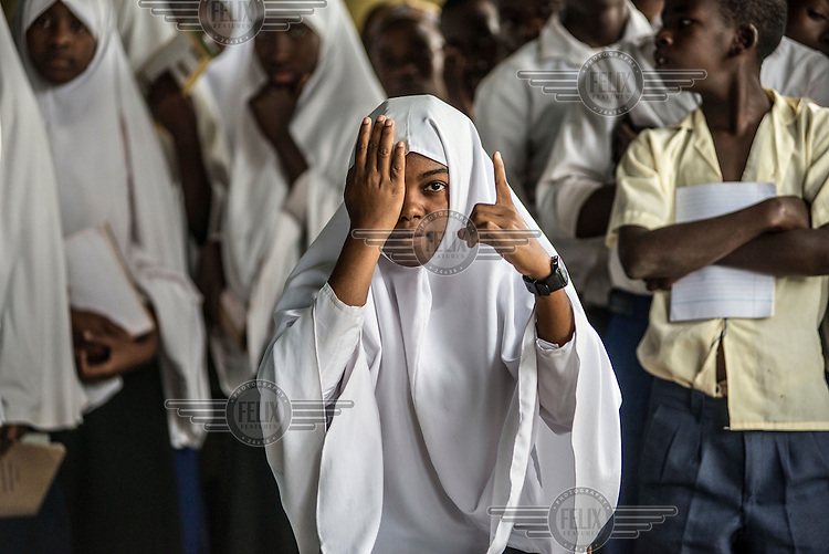 Nachum Fumu, 18, a form four student at the Jongowe secondary school, gets her eyes tested during a mass screening.