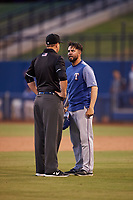 AZL Rangers manager Carlos Cardoza (65) argues with umpire Larry Dillman Jr. after being ejected during an Arizona League game against the AZL Brewers Blue on July 11, 2019 at American Family Fields of Phoenix in Phoenix, Arizona. The AZL Rangers defeated the AZL Brewers Blue 5-2. (Zachary Lucy/Four Seam Images)