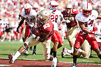 October 31, 2009:   Florida State running back Chris Thompson (23) scores a touchdown during Atlantic Coast Conference action between the North Carolina State Wolfpack and Florida State Seminoles at Doak Campbell Stadium in Tallahassee, Florida.  Florida State defeated N. C. State 45-42.
