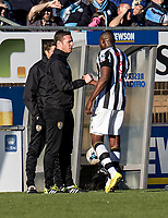 Kevin Nolan manager of Notts County congratulates Shola Ameobi of Notts County as he is substituted during the Sky Bet League 2 match between Wycombe Wanderers and Notts County at Adams Park, High Wycombe, England on the 25th March 2017. Photo by Liam McAvoy.