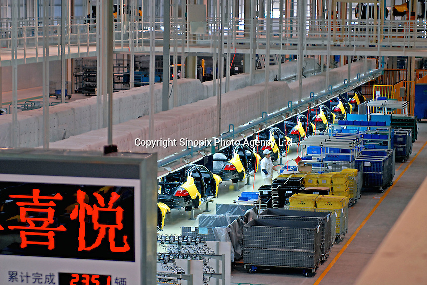 Workers on the production line of the Honda Accord at the new Guangzhou Honda Automobile Co. Ltd. factory. The plant built at a cost of 140 million US$ is one of the most advanced car plants in the world. It has a state of the art production line as well as the world's first total water re-cycling sytem..19 Sep 2006