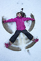 30/01/15<br /> <br /> Freya Kirkpatrick (7) makes a snow angel at Dovedale after heavy overnight snowfall in the Derbyshire Peak District.<br /> <br /> All Rights Reserved - F Stop Press.  www.fstoppress.com. Tel: +44 (0)1335 418629 +44(0)7765 242650