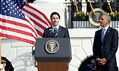 Prime Minister Justin Trudeau of Canada makes remarks as United States President Barack Obama looks on during a welcoming ceremony to the White House for an Official Visit March 10, 2016 in Washington,D.C. <br /> Credit: Olivier Douliery / Pool via CNP