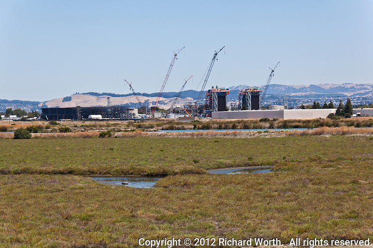 The Russell City Energy Center, a natural gas fired power plant, is under construction near the Hayward Regional Shoreline, a system of fresh and salt water  marshes and wetlands along San Francisco Bay.