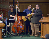 NWA Democrat-Gazette/BEN GOFF @NWABENGOFF<br /> Michael Lavender, on bass, Max Richards on guitar and Matt Schatz on saxophone play as part of a jazz quintet on Sunday Feb. 7, 2016 during the Jazz Communion service at First Presbyterian Church in Bentonville.