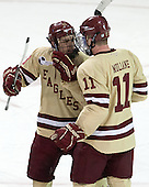 Johnny Gaudreau (BC - 13), Pat Mullane (BC - 11) - The Boston College Eagles defeated the visiting University of Vermont Catamounts to sweep their quarterfinal matchup on Saturday, March 16, 2013, at Kelley Rink in Conte Forum in Chestnut Hill, Massachusetts.