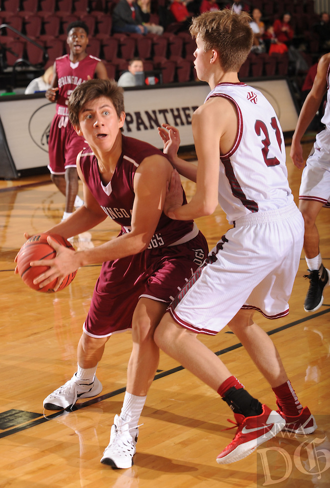 NWA Democrat-Gazette/ANDY SHUPE<br /> David Carachure (left) of Springdale drives to the lane as Luke Fox (21) of Tulsa (Okla.) Holland Hall defends Tuesday. Dec. 29, 2015, during the second half at Siloam Springs High School. Visit nwadg.com/photos to see more photographs from the game.