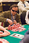 Eric Hershler stacks chips after winning a big hand.