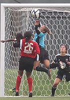 BOYDS, MARYLAND - July 21, 2012:  Didi Haracic (1) of DC United Women sves from Stephanie Goddard (21) of the Virginia Beach Piranhas during a W League Eastern Conference Championship semi final match at Maryland Soccerplex, in Boyds, Maryland on July 21. DC United Women won 3-0.
