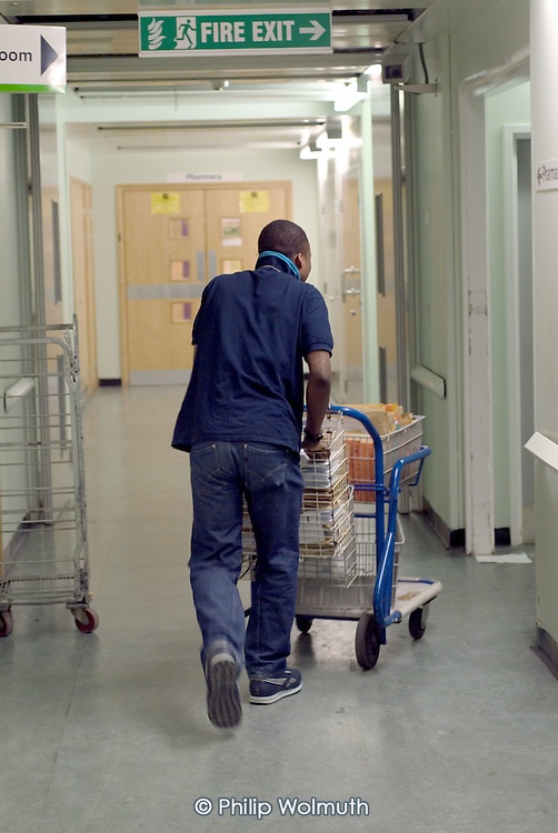 A porter at Homerton Hospital, Hackney, east London, where threatened industrial action by UNISON members employed by multinational ISS Mediclean in catering, portering and cleaning services lead to a deal which took pay from £4.43 to £5.00 an hour (£5.35 from 1 April 2004),  improved annual leave and the introduction of an occupational sick pay scheme.  The claim was part of the Living Wage campaign carried out in partnership with the East London Citizens Organisation (TELCO).