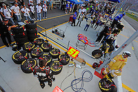 Two different worlds: Left, the Phoenix crew readies for a pit stop while right, a start and park team with 1 set of tires and 2 cans of fuel prepare for their only stop of the race.