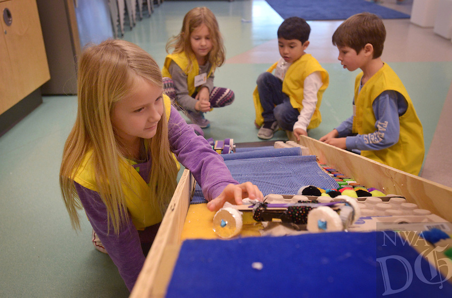 NWA Democrat-Gazette/BEN GOFF @NWABENGOFF<br /> Reese Davis (from left), 7, of Springdale, Isabella Brooks, 6, of Bentonville, Ezra Melendez, 6, of Bentonville and Zack Muench, 7, of Bentonville test traction cars they built on ramp on Monday Jan. 16, 2017 during the I.C.E.: Investigate, Create and Explore All Things Frozen day camp at the Scott Family Amazeum in Bentonville. The camp engaged children age 6-11 with the science of cold, with activities that included making ice sculptures, observing how liquids freeze and experiments with dry ice.