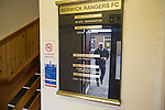 A club official reflected inside the main entrance to Shielfield Park, before the Scottish League Two fixture between Berwick Rangers and East Stirlingshire. The home club occupied a unique position in Scottish football as they are based in Berwick-upon-Tweed, which lies a few miles inside England. Berwick won the match by 5-0, watched by a crowd of 509.
