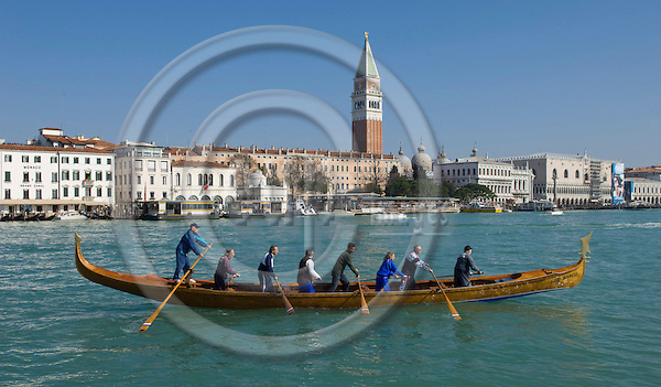 Venice-Italy - March 28, 2010 -- A team of eight rows a gondola on the Grand Canal / Canal Grande (not: Canale Grande), the St. Marc's Campanile in the back -- infrastructure, transport, water, people -- Photo: Horst Wagner / eup-images