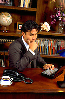 Young Korean businessman age 24 working in office.  St Paul Minnesota USA