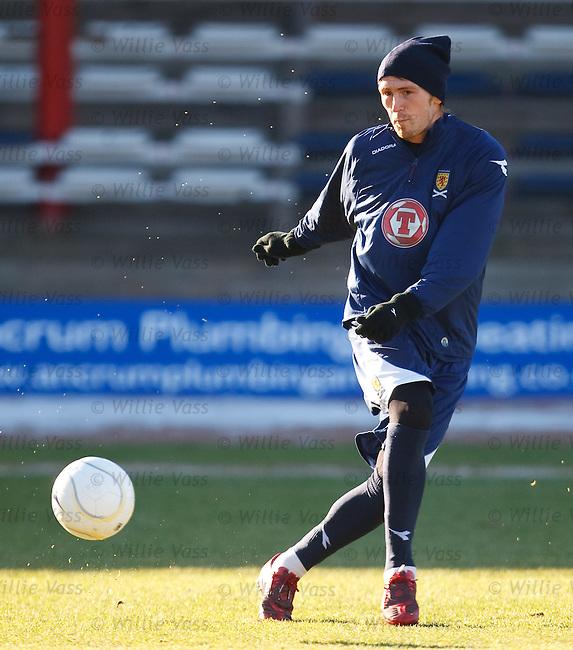 Lee Miller cracks in a shot during Scotland training