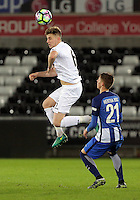 Pictured: Keston Davies of Swansea heads the ball  Tuesday 28 February 2017<br /> Re: Premier League International Cup, Swansea City U23 v Hertha Berlin II at at the Liberty Stadium, Swansea, UK