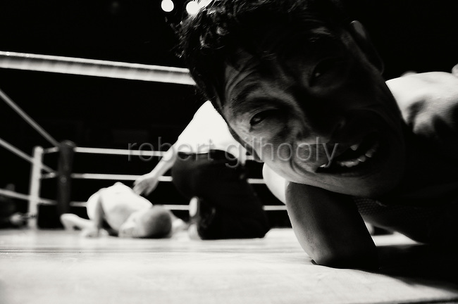 A wrestler screams with pain after felling his opponent during Doglegs, an event for wrestlers with physical and mental handicaps in Tokyo, Japan.