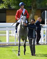 Winner of The Shadwell Dick Poole Fillies' Stakes Dark Lady (right), ridden by Pat Hobbs and trained by Richard Hannon is led into the Winner's enclosure during Racing at Salisbury Racecourse on 5th September 2019