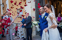 """Spain. Valencia Province. Valencia. Church """"Iglesia de Nuestra Señora de los Ángeles"""". Wedding of Gaetano & Raquel. Celebrations of joy with friends pouring red flowers  on the married couple. Valencia (officially València) is the capital of the autonomous community of Valencia and the third-largest city in Spain. 15.12.18  © 2018 Didier Ruef"""