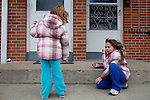 "Kendrick Brinson.LUCEO..Sloan Olson, 3, plays with her sister Tatiana, 6, outside of her family's apartment in January in oil boom-town Williston, North Dakota. Her grandmother Peggy Adrin said the town has ""really changed a lot"" since she first moved there 30 years ago. ""When we first moved here, there was nothing,"" she said. Williston, North Dakota is currently experiencing an influx of people relocating there for the town's third oil boom...Model Released: Yes.Assigning Editor: Michael Wichita."
