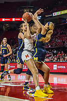 COLLEGE PARK, MD - DECEMBER 28: Shakira Austin #1 of Maryland and Kayla Robbins #5 of Michigan clash. during a game between University of Michigan and University of Maryland at Xfinity Center on December 28, 2019 in College Park, Maryland.