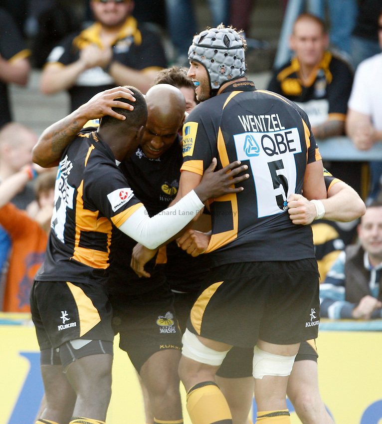 Photo: Richard Lane/Richard Lane Photography. London Wasps v London Irish. Aviva Premiership. 15/09/2012. Wasps' Tom Varndell (c) celebrates his second try with Christian Wade and Marco Wentzel.