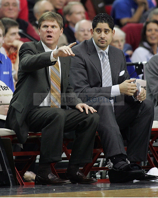 UK men's basketball assistant coaches John Robic and Orlando Antigua watch the second half of UK's 80-68 win over Georgia at Stegeman Coliseum  in Athens, GA on Wednesday, March 3, 2010. Photo by Britney McIntosh | Staff