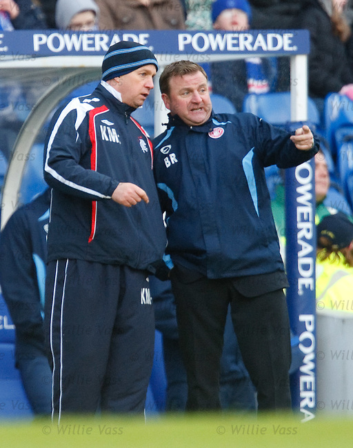 Kenny McDowall has a chat with Accies boss Billy Reid during the match