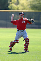 Hank Conger #16 of the Los Angeles Angels participates in fielding practice during spring training workouts at the Angels complex on February 16, 2011  in Tempe, Arizona. .Photo by:  Bill Mitchell/Four Seam Images.