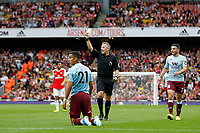Referee, Jonathan Moss brandishes a yellow card during the Premier League match between Arsenal and Aston Villa at the Emirates Stadium, London, England on 22 September 2019. Photo by Carlton Myrie / PRiME Media Images.