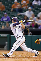 Jerrick Suiter #31 of the Texas Christian Horned Frogs follows through on his swing against the Sam Houston State Bearkats at Minute Maid Park on February 28, 2014 in Houston, Texas.  The Bearkats defeated the Horned Frogs 9-4.  (Brian Westerholt/Four Seam Images)