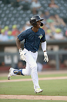 Right fielder Gerson Molina (12) of the Columbia Fireflies runs out a batted ball in a game against the Augusta GreenJackets on Saturday, June 1, 2019, at Segra Park in Columbia, South Carolina. Columbia won, 3-2. (Tom Priddy/Four Seam Images)