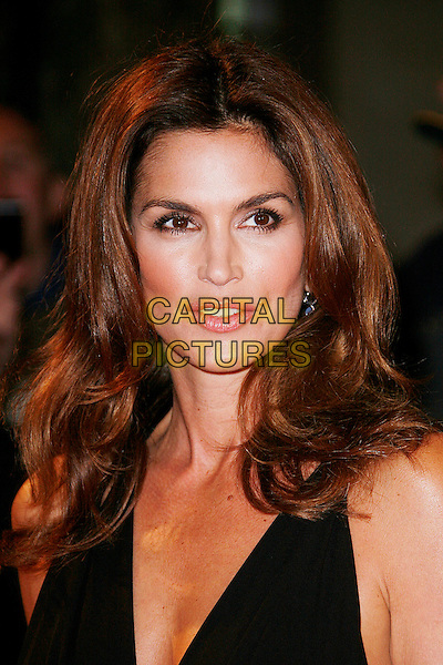 "CINDY CRAWFORD .Opening Gala of the 2009 London Film Festival - the World Premiere of ""Fantastic Mr Fox"" at the Odeon, Leicester Square, London, England, UK, October 14th 2009.portrait headshot black .CAP/DAR.©Darwin/Capital Pictures."