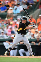Outfielder Travis Snider (23) of the Pittsburgh Pirates during a spring training game against the Baltimore Orioles on March 23, 2014 at McKechnie Field in Bradenton, Florida.  Baltimore and Pittsburgh played to a 7-7 tie.  (Mike Janes/Four Seam Images)