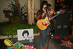 "ZANE SUAREZ. The guitarist leads George Harrison songs at the George Harrison Public Birthday Celebration by the Alliance for Survival, hosted by Jerry Rubin and ""Breakfast with the Beatles"" radio host Chris Carter at George Harrison's star on the Walk of Fame. Hollywood, CA, USA. February 25, 2010."