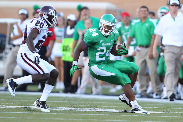 Denton, TX - SEPTEMBER 8: Derricus Purdy #20 of the Texas Southern Tigers runs down Brandin Byrd #24 of the North Texas Mean Green at Apogee Stadium in Denton on September 8, 2012 in Denton, Texas. Photo by: Rick Yeatts