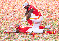 2nd February 2020, Miami Gardens, Florida, USA;  Kansas City Chiefs Cornerback Rashad Fenton (27) lays on the confetti on the field as Kansas City Chiefs Defensive End Demone Harris (52)  pretends to give him chest compressions as they celebrate winning the NFL Super Bowl LIV  game against the San Francisco 49ers at the Hard Rock Stadium in Miami Gardens