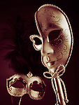 Two beautiful Venetian masks on black red background