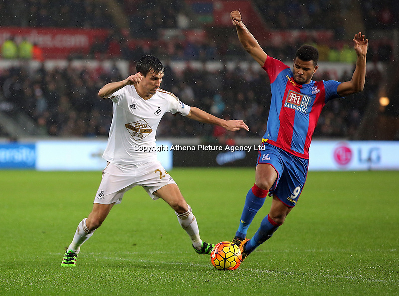 (L-R) Jack Cork of Swansea marked by Fraizer Campbell of Crystal Palace during the Barclays Premier League match between Swansea City and Crystal Palace at the Liberty Stadium, Swansea on February 06 2016