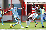 Christian Nade with Partick duo Abdul Osman and Frederic Frans
