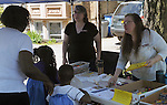 Volunteers answering questions at one  of the many community service groups provided information at various booths at the 11th Annual Mid-town Make a Difference Day Celebration on Franklin Street, in Kingston, NY on Saturday, June  18, 2016. Photo by Jim Peppler. Copyright Jim Peppler 2016.