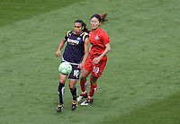 LA Sol's Marta and Washington Freedom's Homare Sawa. The LA Sol defeated the Washington Freedom 2-0 in the opening game of Womens Professional Soccer at Home Depot Center stadium on Sunday March 29, 2009.  .Photo by Michael Janosz