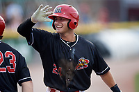 Batavia Muckdogs Bubba Hollins (24) celebrates a J.D. Osborne (23) home run during a game against the Lowell Spinners on July 16, 2018 at Dwyer Stadium in Batavia, New York.  Lowell defeated Batavia 4-3.  (Mike Janes/Four Seam Images)