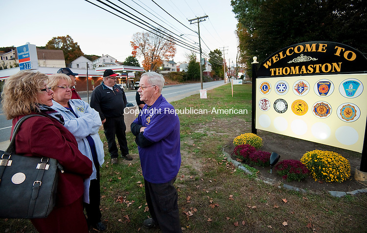 THOMASTON, CT--- -101415JS01---Kimberly Curry, Branch Manager for the Thomaston Savings Bank main office, left, and Carol Hoebel, Lions Club Secretary, center, talk with Lions Club member Robert Norton, Sr., following the dedication of the new &quot;Welcome to Thomaston&quot; sign at Seth Thomas Park in Thomaston on Wednesday. The Thomaston Lions Club has been working on getting the sign installed showing the logos for all cicic groups in Thomaston. The sign was made possible through a grant from Thomaston Savings Bank. <br /> Jim Shannon Republican-American